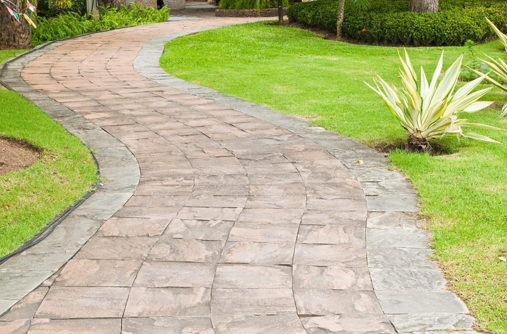 Stone pathway in the garden. Driveway Paving Boca Raton